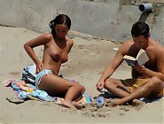 (10 pictures) Yummy naturist wives and their lucky husbands relax in the sun and sand and get a little frisky